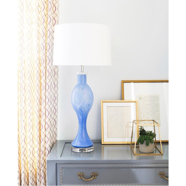 Handblown glass in the most beautiful blue accentuates the soft curves of the Flare Lamp. Shape and color lend to many...