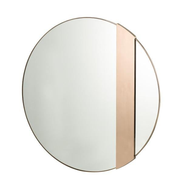 A classic, round mirror with rose gold trim detailing, accented with a statement, off-centre stainless steel band finished...