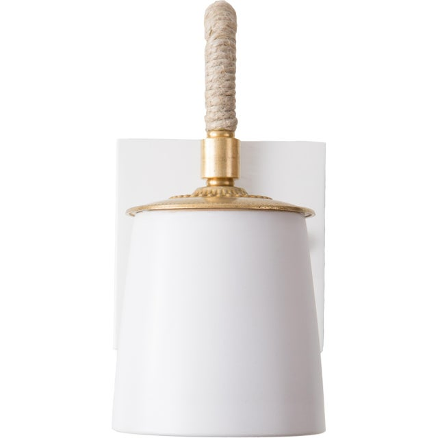 Adorable chic ceramic wall sconce. This takes a single Type B bulb, 60 Watt Max.