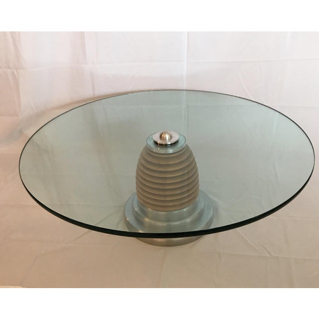 Two available. J. Wade Beam for Brueton futuristic style round wood and stainless steel coffee table. This table is in...