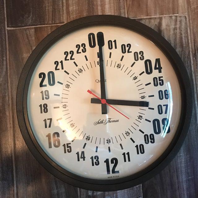 Rare Seth Thomas Fire/Police/Military 24 hour wall clock. Uses a single AA battery. Keeps perfect time.