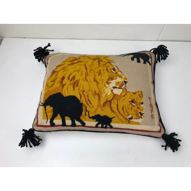 Amazing Vintage Needlepoint Lion Pillow available! Elephant silhouettes accented in the corners. This piece is perfect for...