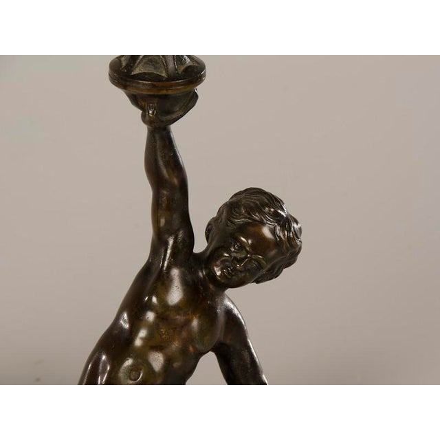 A pair of cast bronze candlesticks each featuring a kneeling putto from Italy c.1880 - Image 5 of 7