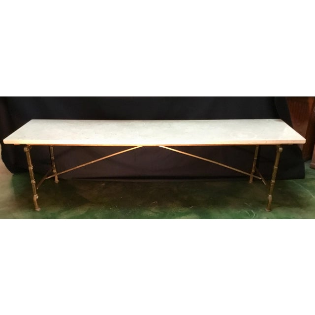 """This stylish coffee table has a 1"""" thick polished travertine top and bronzed base. It was designed with elegant restraint..."""