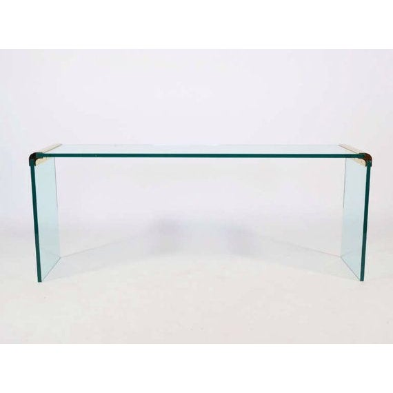 A modern 1970s Leon Rosen for Pace Collection brass and glass console or sofa table. Highly refined with a minimal...