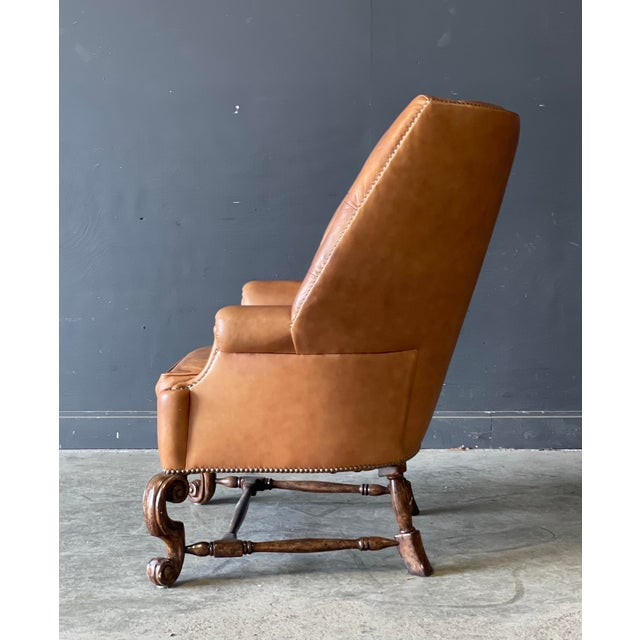 Vintage Leather Wing back chair exceptional quality with the perfect amount of wear.