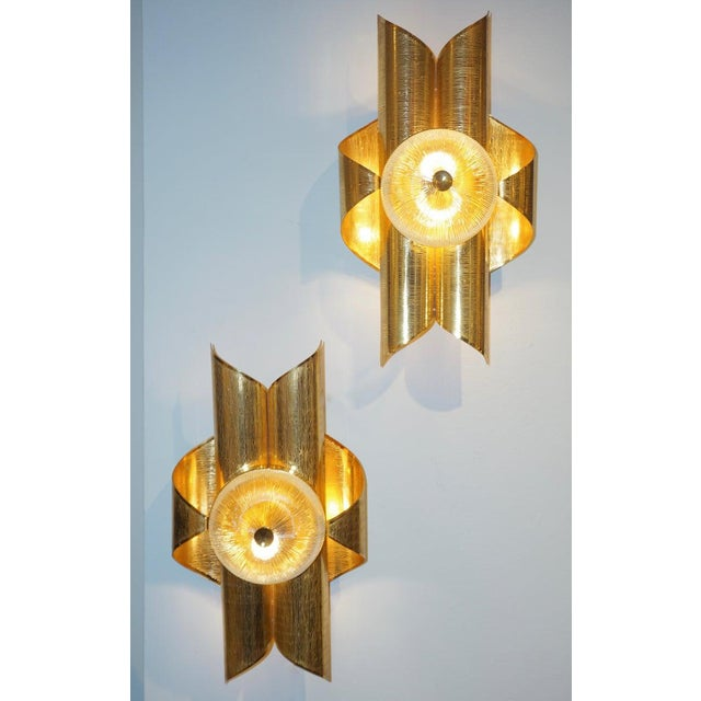 Mid-Century Modern French Hollywood Regency style wall lights, entirely handcrafted, with an Art Deco flair. The folded...