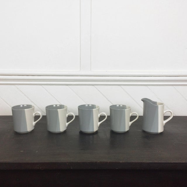 A set of 4 modern vintage stoneware mugs and a matching pitcher with an asymmetrical line color block pattern. A great...