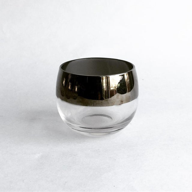 """hand to mouth. Low, wide roly poly glass surfaces silver band detail at the top. DETAILS Pattern: Wide 1"""" Silver Band..."""