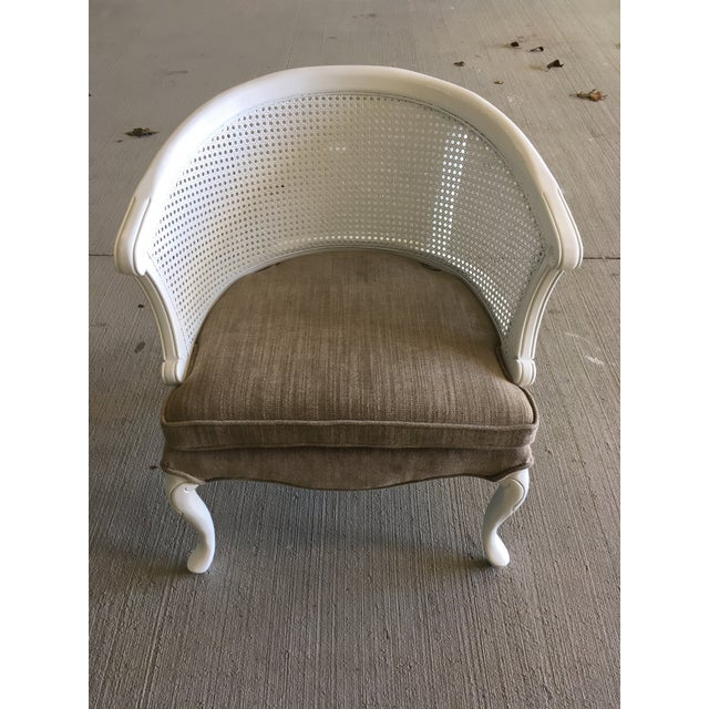 Vintage pair of French style caned barrel back chairs newly painted and upholstered in a taupe fabric.