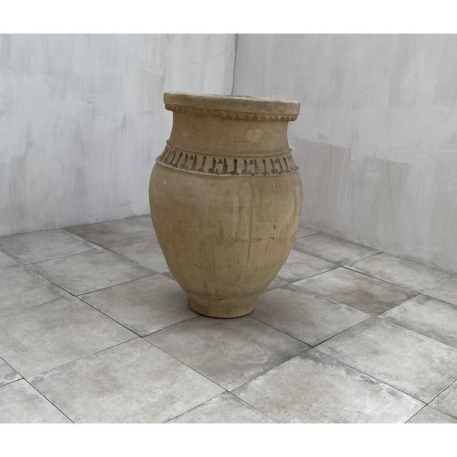 An antique terracotta vessel from Lucena, Córdoba. This piece was built by hand without a potter's wheel using a...