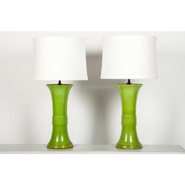Pair vintage green porcelain table lamps. In excellent working condition; standard bulbs. White linen shades with silk...