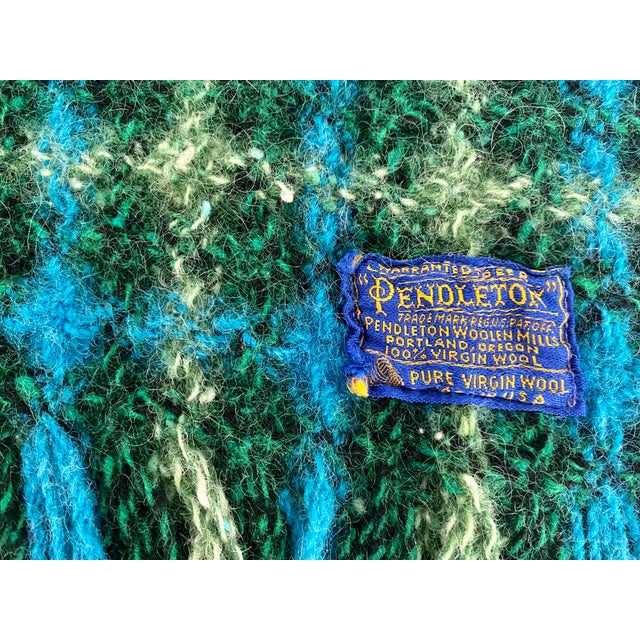 """Beautiful woven blue and green Pendleton wool blanket in vivid colors and excellent condition. Fringe adds another 3"""" to..."""