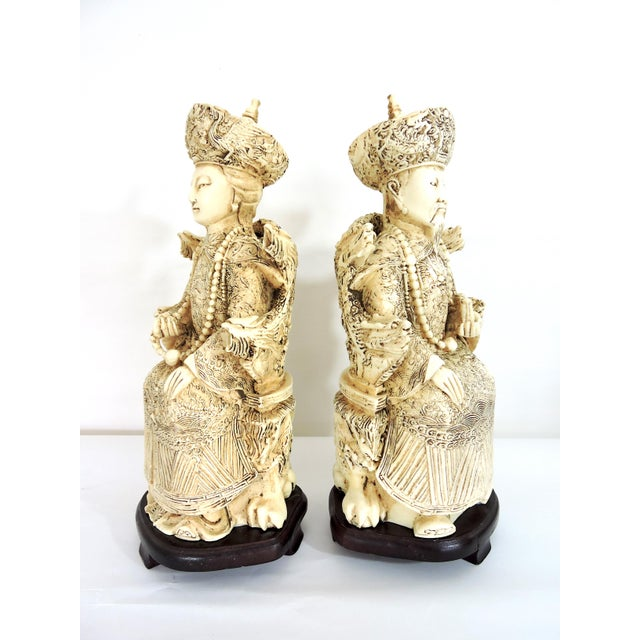 """Vintage pair of highly detailed Chinese Emperor and Empress statues or nobles. The figures measure just under 13"""" tall and..."""