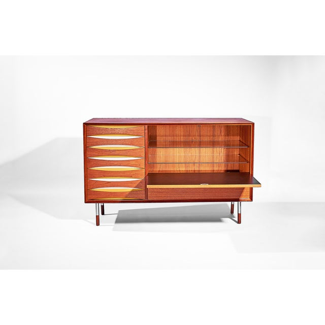 Arne Vodder Bar Cabinet with fold down front and seven drawers Made in Denmark, circa 1958 - 1959 Made of teak with rare...
