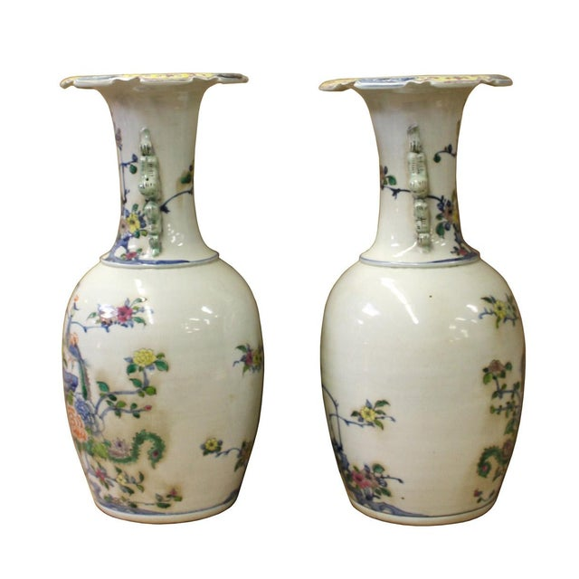 This is a pair of handmade white base porcelain vases with decent graphic of bird and flower on the body. There are dragon...
