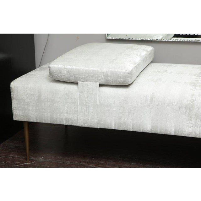 "Sleek custom daybed with removable pillow and brass legs - Piece is COM ""Customers Own Material""."