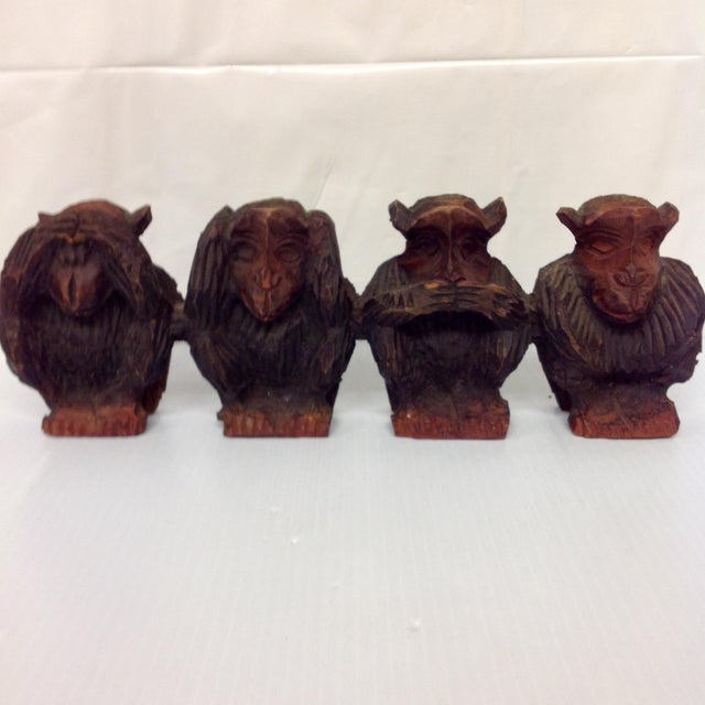 Vintage hand carved wise monkeys sculpture. A rare rendering of the classic 3 wise monkeys, includes the 4th monkey...the...