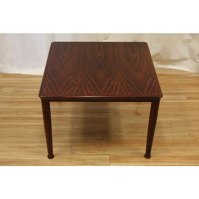 These rosewood tables are in very good to excellent condition with only the smaller of the two tables showing a light...