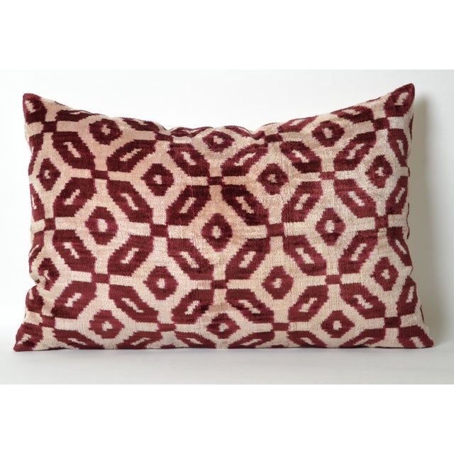 Hand-loomed Bordeaux silk-velvet accent pillow with a solid, cotton back. Pillow has a hidden zipper. A down feather...