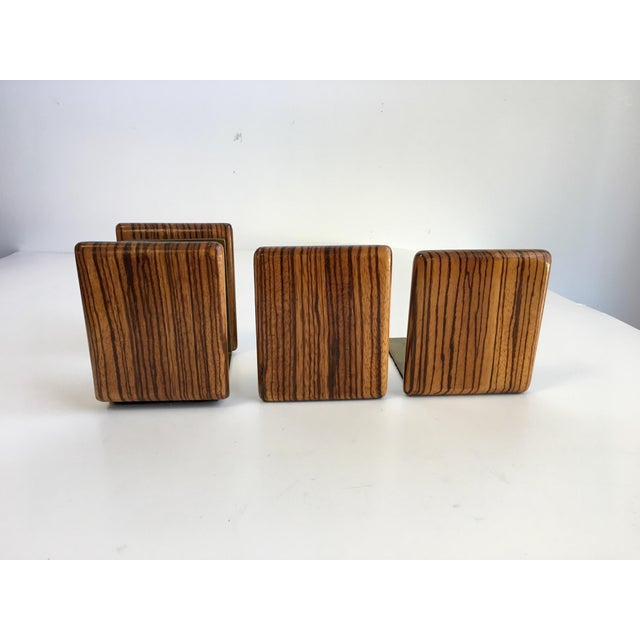 A handsome set of brass and zebra wood bookends with matching mail holder. This set is so unusual and would look amazing...