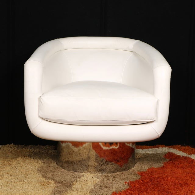 Amazing swivel lounge chair by Leon Rosen for Pace Collection. It features a leather body, barrel back, and a pedestal...
