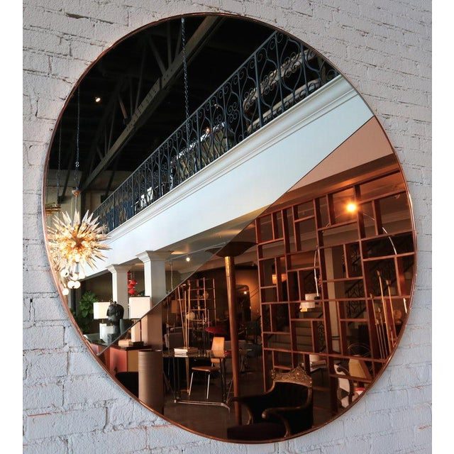 Custom round mirror with half silver and half apricot peach with a copper frame. Can be hung with line horizontally,...
