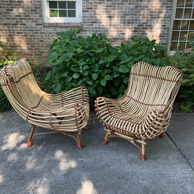 Natural rattan armchair with custom made back and seat cushions. Leather tie accent. Indoor and covered porch safe. Sturdy...