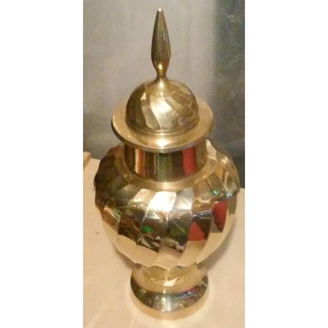 Very nice brass urn with lid. Pedestal style with spiral design. Urn is in great condition and is 14 inches tall with lid...