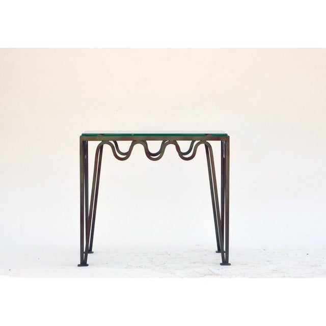 Undulating verdigris iron and glass side table in the style of Jean Royère. Great as a pair of sofa end tables, a 2 part-...