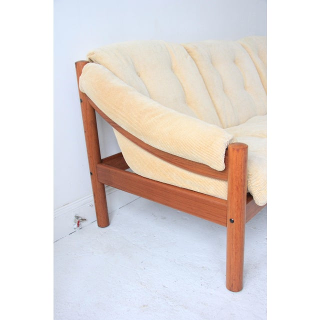 Vintage Mid-Century Modern Domino Mobler Tufted Sofa. Solid teak wood frame with comfortable tufted seats that slide in to...
