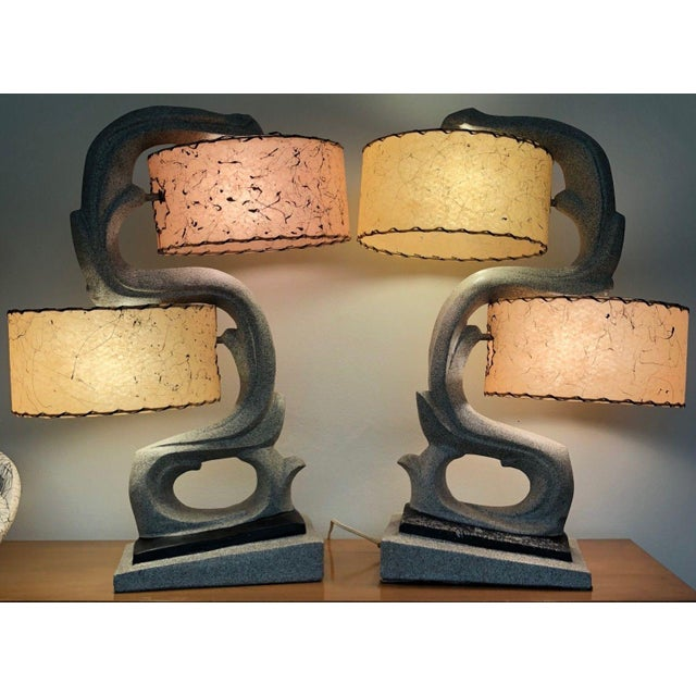 For your consideration we are presenting for sale an amazing pair of rare atomic era chalkware table lamps with their...