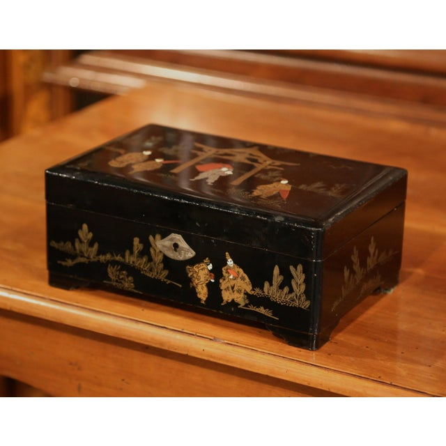 Top your vanity with this interesting makeup box, which was crafted in France, circa 1880. The black lacquered box is...