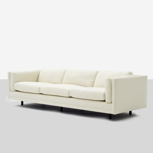 A three-seat Tuxedo sofa by Harvey Probber recently restored in a square-form quilted JAB fabric, down cushions.