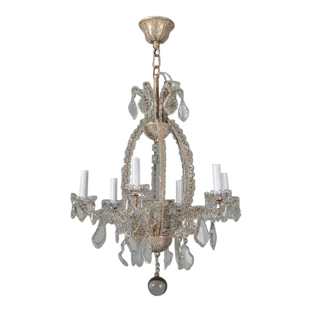 Pair circa 1900 Italian six light chandeliers with frames covered in clear, flower-shaped crystal beads, cut crystal...
