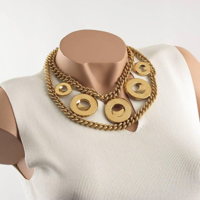 Lovely impressive large choker necklace designed by Julie Borgeaud for IMAI. Heavy gilt metal chain with textured, ornate...