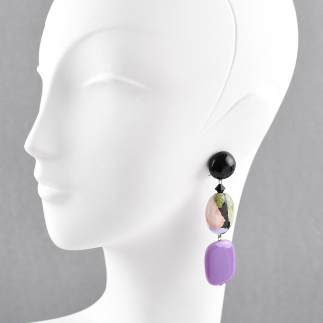 Romantic Angela Caputi, made in Italy resin clip on earrings. Dangling shape with purple color pebble contrasted with...
