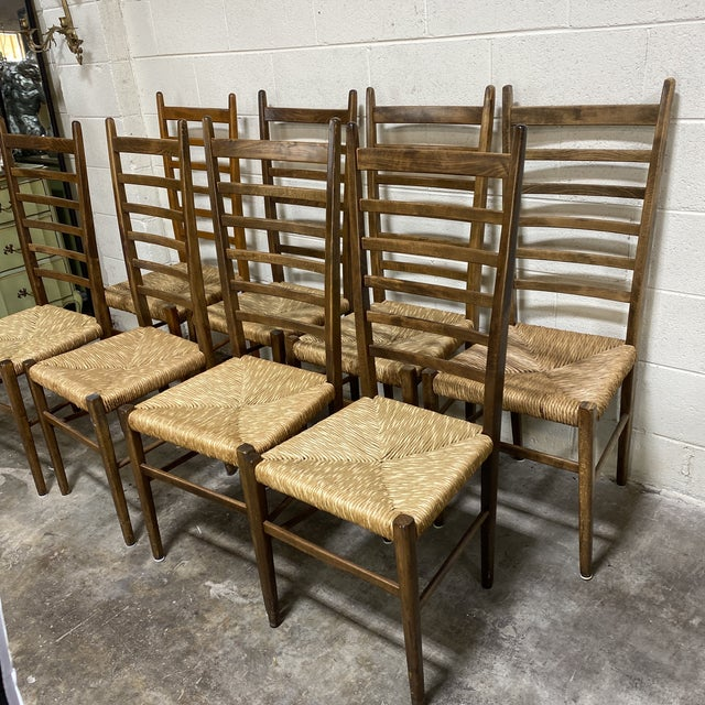 "Engraved "" made in Italy"" on each chair, this set of wooden ladder back chairs are in great vintage condition. They..."
