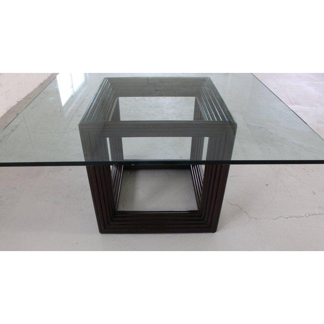Very sharp looking rattan cube shape base thick glass top square dining or conference table.