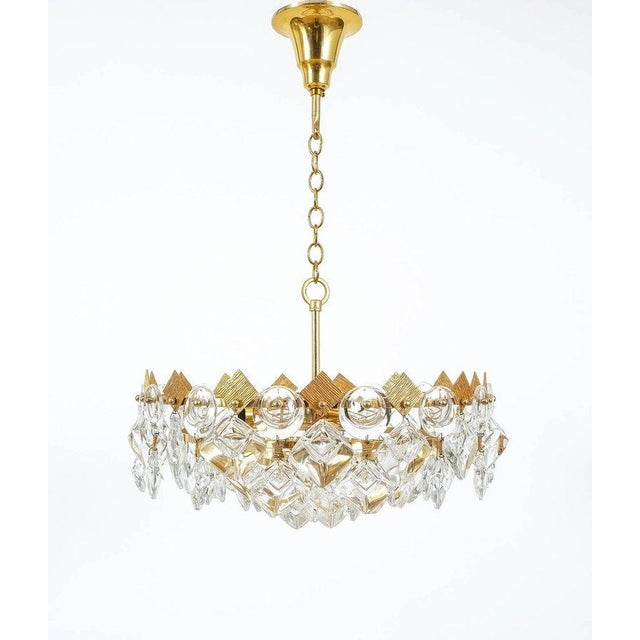 Delicate Palwa light composed of jewel-like circular and rectangular glass pieces and grained brass plates in excellent...