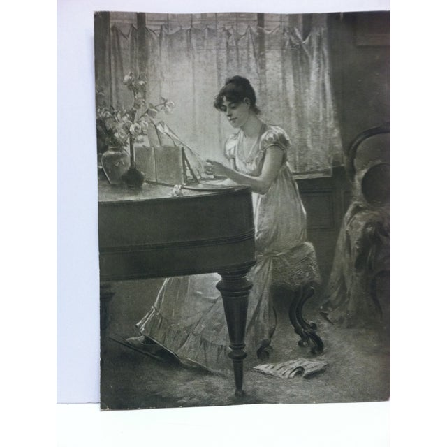 """This is a vintage black and white print that is titled """"The Old-Old Song"""" by Percy Moran. The print is in good condition..."""