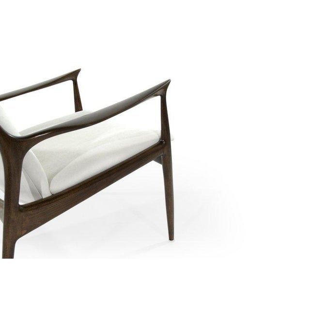 Pair of sculptural Danish modern lounge chairs by Ib Kofod-Larsen. Sculptural frames fully restored. Seat and backrest...