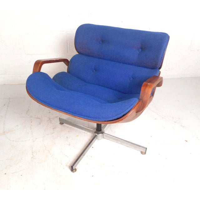 A beautiful vintage modern lounge chair that swivels and tilts ensuring maximum comfort. This unique chair features thick...