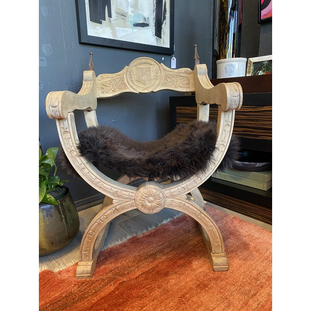 Stunning Mid-19th C. French hand-carved throne chair. Solid oak with a newly upholstered dark brown shearling sling seat....