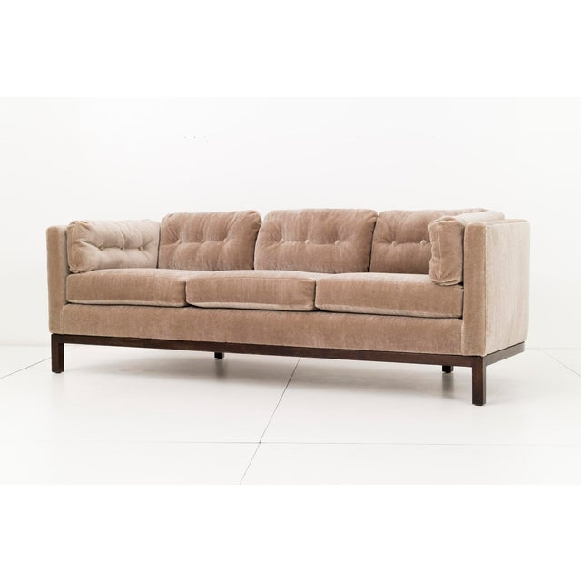 Roger Sprunger designed sofa, great plains mohair upholstery with walnut base. Dunbar text on decking. Attached button...