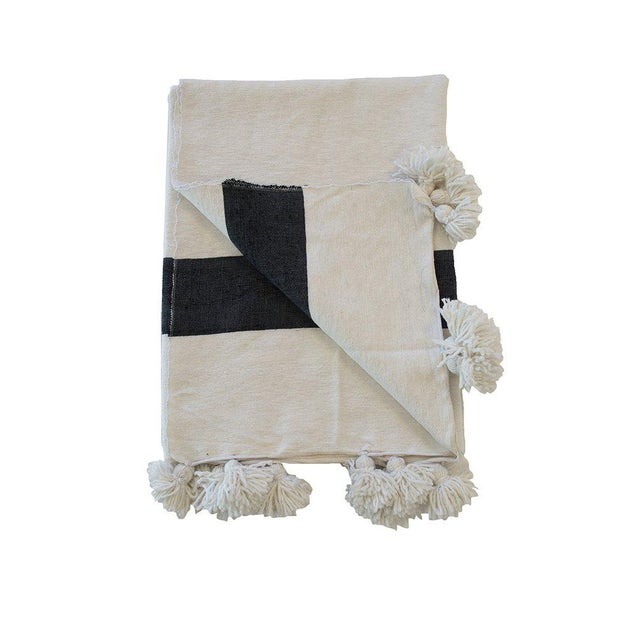 Our founder Katia design this beautiful hand-woven Moroccan pom pom blanket. It is made from handspun cotton and finished...