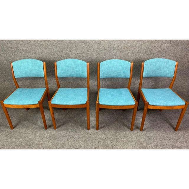 Here is a beautiful set of four 1960s Scandinavian modern dining chairs in solid oak designed by Poul Volther and produced...