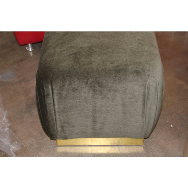 A nice pair of Poufs or ottomans with brass banding along the base. They have been re-upholsetred but the brass is...