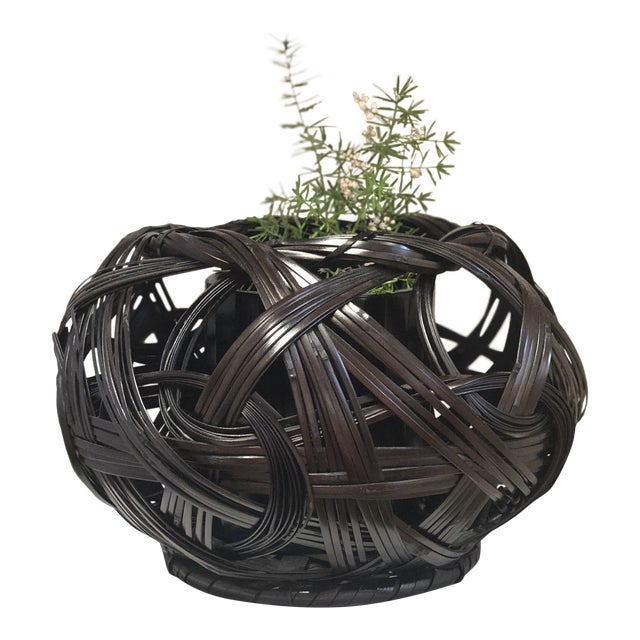 Bamboo baskets fashioned in a traditional Japanese style. This Japanese basket can be used as a flower basket as shown in...