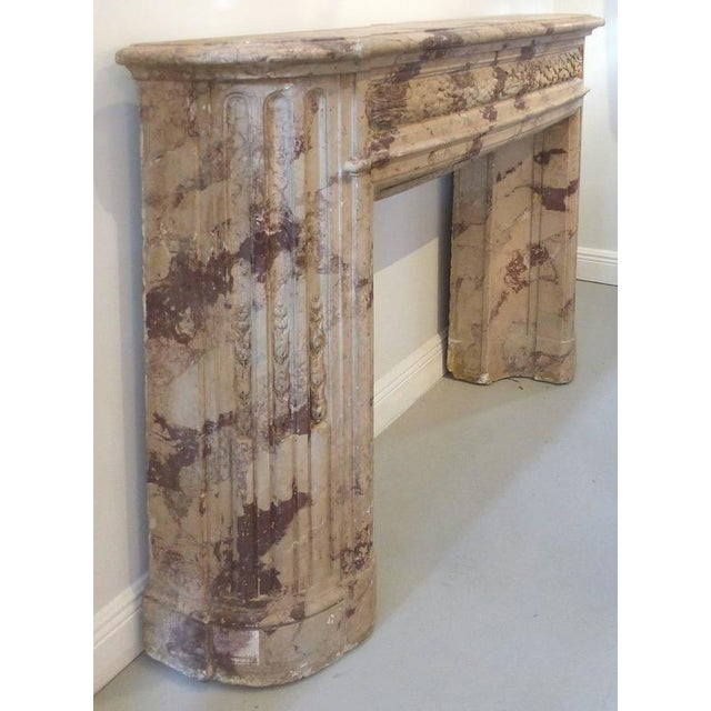 This is an Italian turn of the century antique terracotta fireplace with a faux-marble finish. The fireplace incorporates...